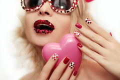 Manicure with hearts. Stock Photos