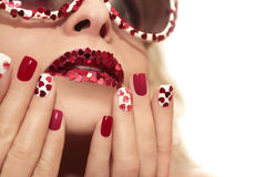 Manicure with hearts. Stock Image