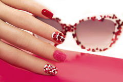 Manicure with hearts. Royalty Free Stock Images