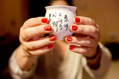 Manicure with hieroglyphs close-up. Attributes to royalty free stock photography