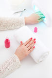 Manicure and hybrid nails painting Stock Photos