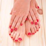 Manicure i pedicure. czerwień obrazy royalty free