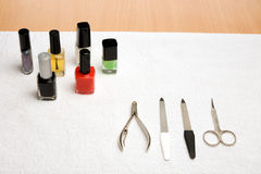 Manicure instruments. Picture of manicure instruments and a lot of nail varnish Royalty Free Stock Photo