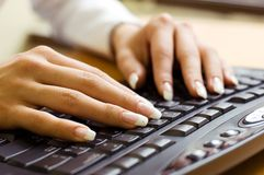 Manicure and keyboard. Young woman's hands on a keyboard Stock Photos