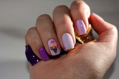 Original manicure covered with gel varnish with an ice cream pat royalty free stock image