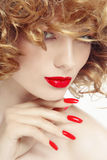Manicure and lipstick Stock Image