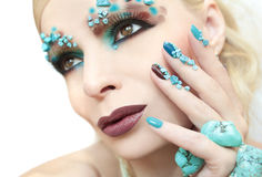 Manicure and makeup with beads and turquoise. Stock Images