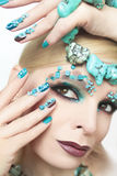 Manicure and makeup with beads and turquoise. Stock Photos