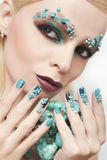Manicure and makeup with beads and turquoise. Stock Image