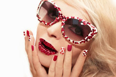 Manicure and makeup with hearts. Royalty Free Stock Photo