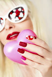 Manicure and makeup with hearts. royalty free stock image