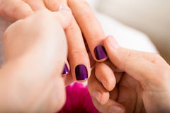 Manicure making in beauty spa salon Stock Photo