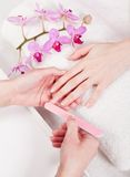 Manicure making in beauty spa salon Stock Image