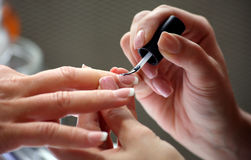 Manicure making female hands covering of enamel Stock Photo