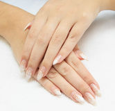 Manicure making - female hands, covering enamel Royalty Free Stock Image