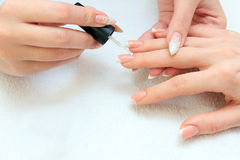 Manicure making - female hands, covering of enamel Royalty Free Stock Images