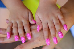 Manicure. D girl`s hand on mother`s hand Royalty Free Stock Photos