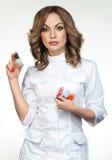 Manicure master holding nail polish Stock Image