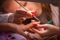 Manicure. Master make nail extension royalty free stock photo