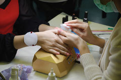 Manicure. Master make nail extension. Finger closeup stock photos
