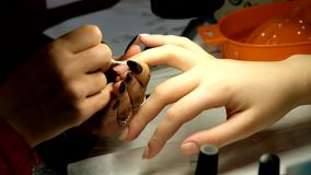Manicure master works with client stock footage