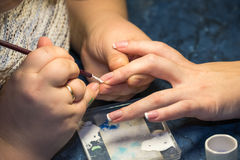 Manicure master works with client Stock Photography