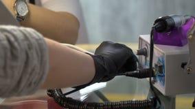 Manicure maszyna na szklanym stole zbiory