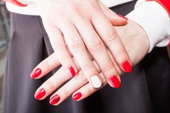 Manicure. Modern manicure work shown on a womans hands Royalty Free Stock Photo