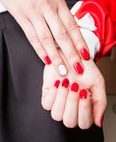 Manicure. Modern manicure work shown on a womans hands Royalty Free Stock Photos