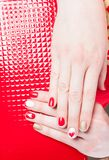 Manicure. Modern manicure work shown on a womans hands Stock Photo