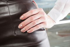 Manicure. Modern manicure work shown on a womans hands Royalty Free Stock Photography