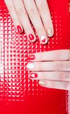 Manicure. Modern manicure work shown on a womans hands Stock Photography