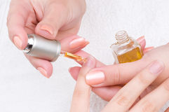 Manicure - moisturizing and nutrition Royalty Free Stock Image