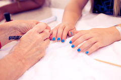 Manicure and nail care. Spa procedures including manicure and nail polish even for teens Stock Photo
