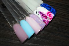 Manicure nail color design samples. Nail art handmade samples on stock photo