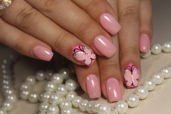 Manicure nail design with a butterfly pattern. Manicure nail design for beautiful girls, summer 2017 stock photography