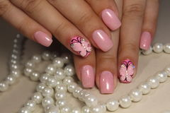 Manicure nail design with a butterfly pattern. Manicure nail design for beautiful girls, summer 2017 royalty free stock photos