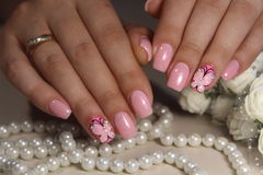 Manicure nail design with a butterfly pattern. Manicure nail design for beautiful girls, summer 2017 stock images