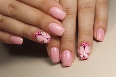 Manicure nail design with a butterfly pattern. Manicure nail design for beautiful girls, summer 2017 royalty free stock photography
