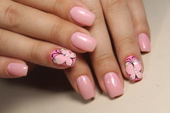 Manicure nail design with a butterfly pattern. Manicure nail design for beautiful girls, summer 2017 stock image