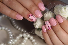 Manicure nail design with a butterfly pattern. Manicure nail design for beautiful girls, summer 2017 stock photos