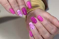 Manicure nail design with flower royalty free stock photography