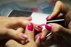 Manicure nail paint. Nail art closeup photo Royalty Free Stock Image