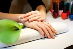 Manicure nail paint pink color stock photos