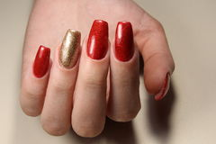Manicure nails red and gold royalty free stock photography