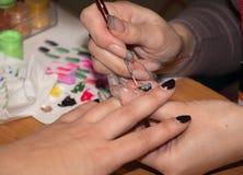 Manicure nero Immagini Stock
