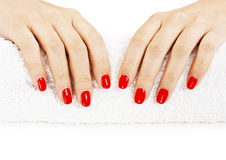Manicure - nice manicured woman nails with red nail polish Royalty Free Stock Photo