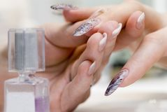 Manicure one's nails. Effective manicure with artificial nails Stock Photography