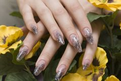 Manicure one's nails. Effective manicure with artificial nails Stock Image