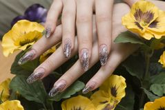Manicure one's nails. Effective manicure with artificial nails Royalty Free Stock Photo